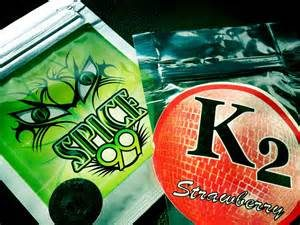 Spice 99 logo in green and black with K2 Strawberry logo